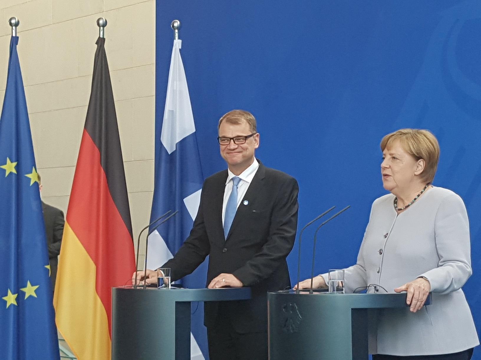 Juha Sipilä und Angela Merkel
