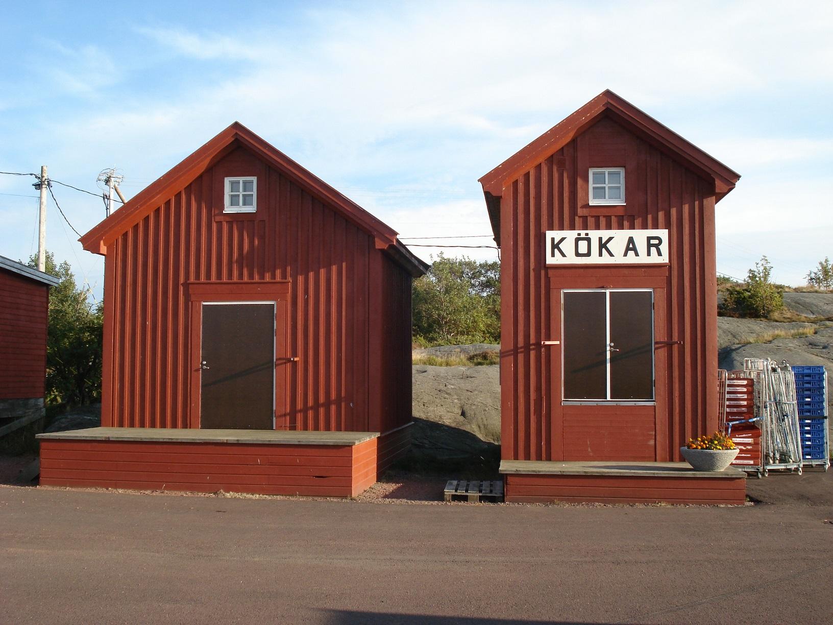 Rote Holzhäuser auf der Insel Kökar, Aland